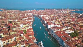 Aerial drone video of iconic and unique Grand Canal crossing city of Venice as seen from high altitude, Italy.
