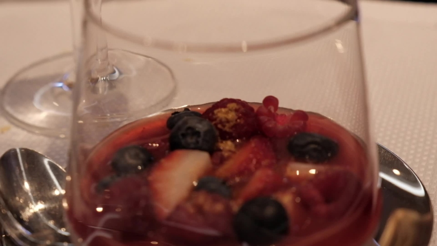 Dessert with berries, strawberries, blueberries and raspberries in a glass glass in a restaurant | Shutterstock HD Video #1061178931