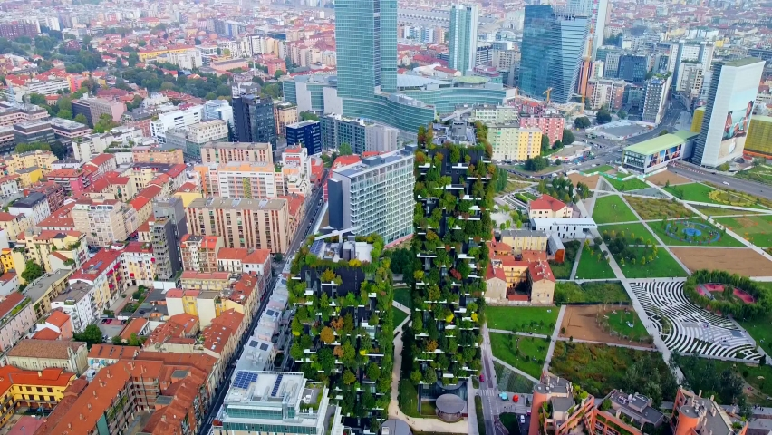 Aerial view of ecological skyscrapers with many trees on each balcony. Bosco Verticale. Modern architecture, vertical gardens, terraces with plants. Ecology. Green Planet. Milan. Italy, 01/10/2020: | Shutterstock HD Video #1061184196