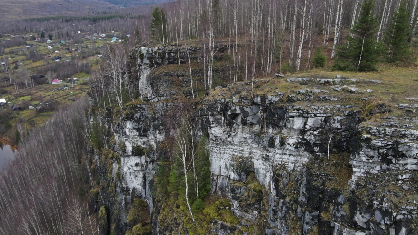 Breathtaking flight on the quadcopter along the cliff | Shutterstock HD Video #1061184652