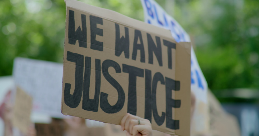 2020 year Issues: Black Lives Matter Protest and Coronavirus Pandemic. Crowds of People with Signes about Justice, Racism and COVID-19. 4K Background Slow Motion Shot Royalty-Free Stock Footage #1061184871