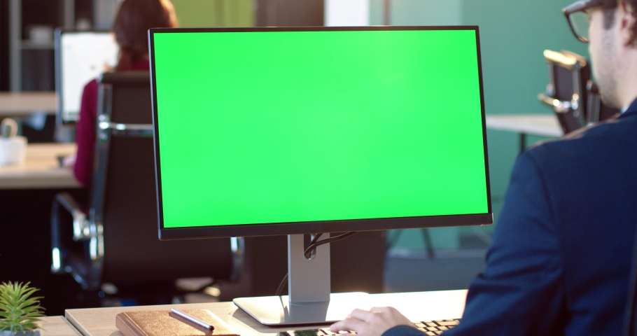 Close up of monitor in office. Green screen. Employee works on computer, types text, enters data into the database. Chromokey. Royalty-Free Stock Footage #1061189479