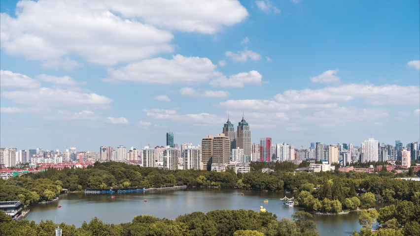 Aerial view of the city park with urban skyline. | Shutterstock HD Video #1061195287