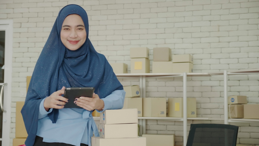 Muslim business women use tablet to check delivery to customers. Delivery management In office with modern technology. Concept Express delivery business Royalty-Free Stock Footage #1061196199