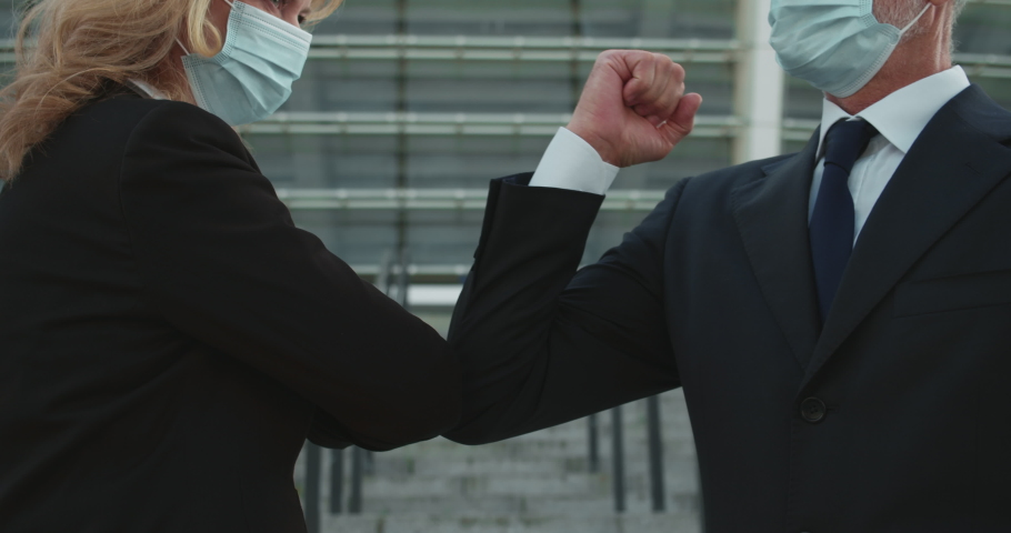 Business partners doing elbow bump instead handshake, safety during pandemic Royalty-Free Stock Footage #1061200396