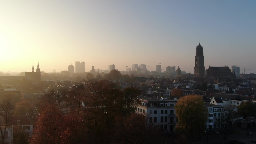 Cinematic 4k aerial video of historic Utrecht city center with the Dom Church with foggy golden light and fall colours | Shutterstock HD Video #1061204410