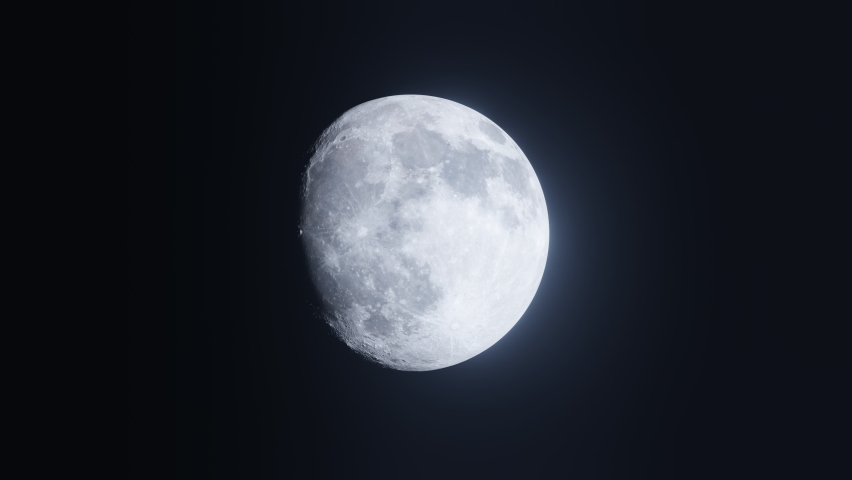 Rotating Moon in different phases with detail surface. Footage of the flight to the Moon with a copy space and a great transition to black. 3D animation video in 4K. Royalty-Free Stock Footage #1061205871