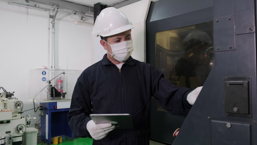 Asian male worker or engineer wearing disposal face mask for protect dust smoke and corona virus while working in workplace or factory .Engineering and industrial concept Royalty-Free Stock Footage #1061208712