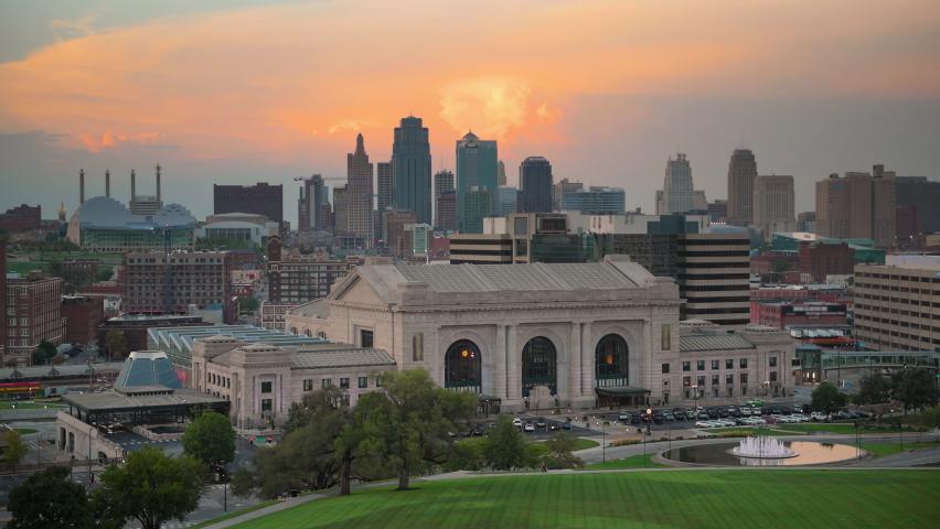 Kansas City, Missouri, USA downtown skyline with Union Station at dusk.