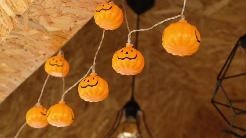 Happy Halloween! Halloween or Dia de los Muertos party decoration, lighting. Swinging garland of light bulbs, pumpkins, garland. | Shutterstock HD Video #1061213932
