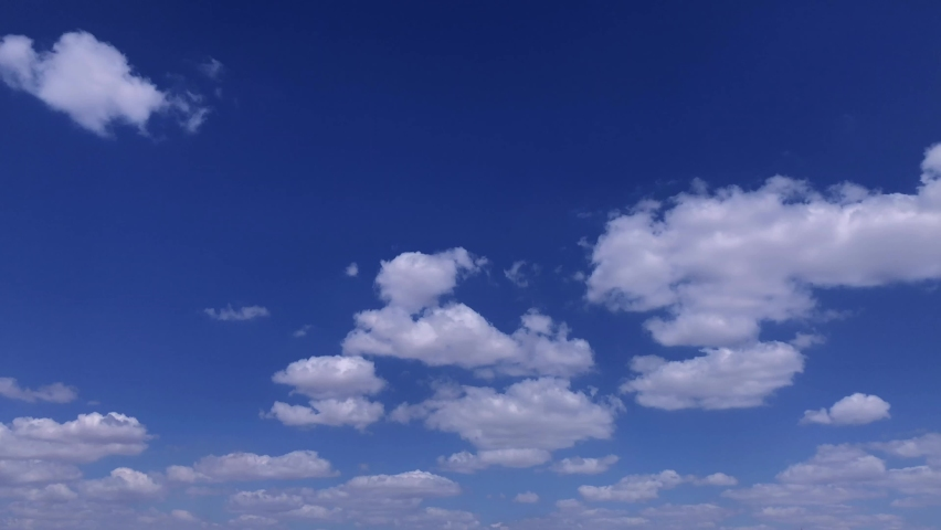 BLUE SKY cloud time lapse background Time lapse clouds 4k rolling puffy cumulus cloud relaxation weather dramatic beauty color atmosphere background Aerials Slow motion abstract  Royalty-Free Stock Footage #1061218957