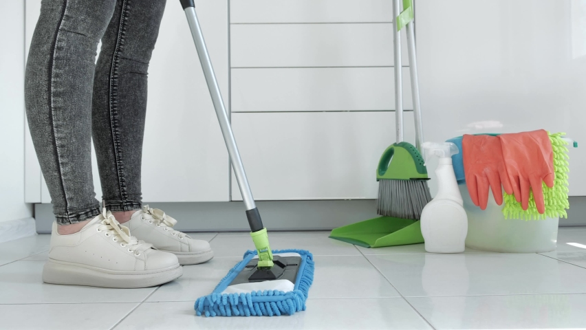 View of female feet, woman with mop cleaning floor At kitchen. House cleaning concept 4k | Shutterstock HD Video #1061219977