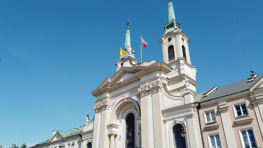 Shot of Catholic church with flags on roof. | Shutterstock HD Video #1061230456