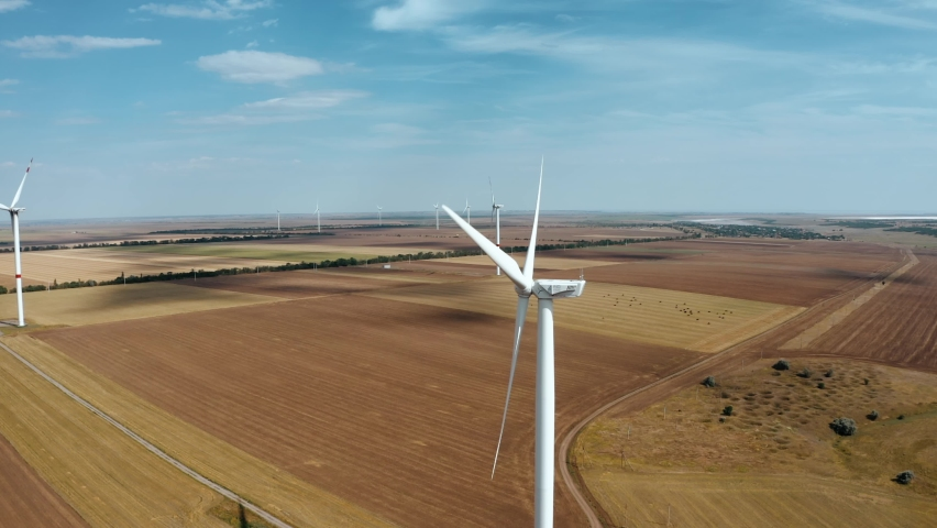 Wind farm top view. Alternative natural source, preservation of ecology. | Shutterstock HD Video #1061249524