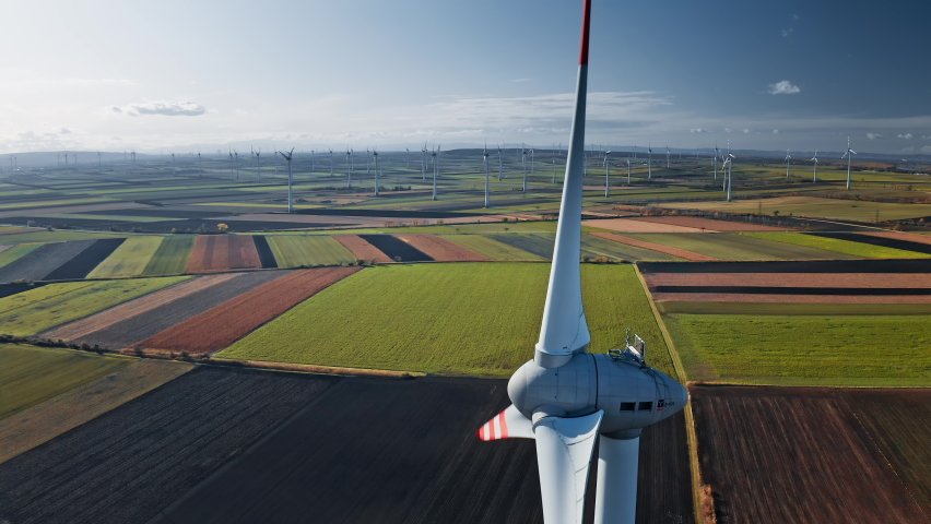 Wind mills rotating by the force of the wind and generating renewable energy   Shutterstock HD Video #1061254396