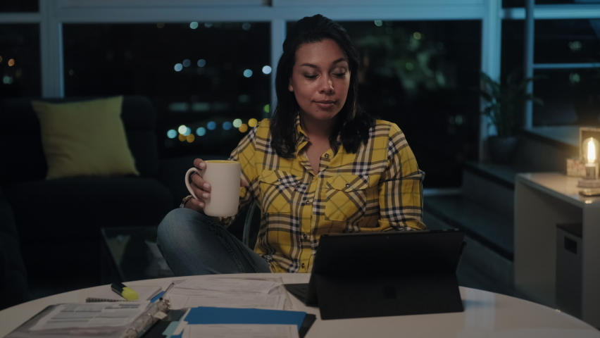 Multiethnic woman doing budget and counting money at home, girl checking dollars to pay utilities bill late at night. Young latin people reviewing invoice, planning family business and filing taxes | Shutterstock HD Video #1061254633