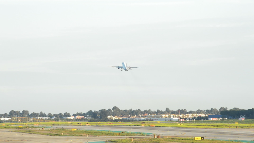 Airplane taking off from airport runway | Shutterstock HD Video #1061255695