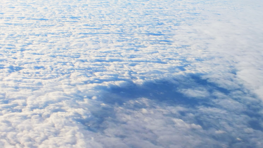 Aerial view of Clouds from airplane | Shutterstock HD Video #1061255716