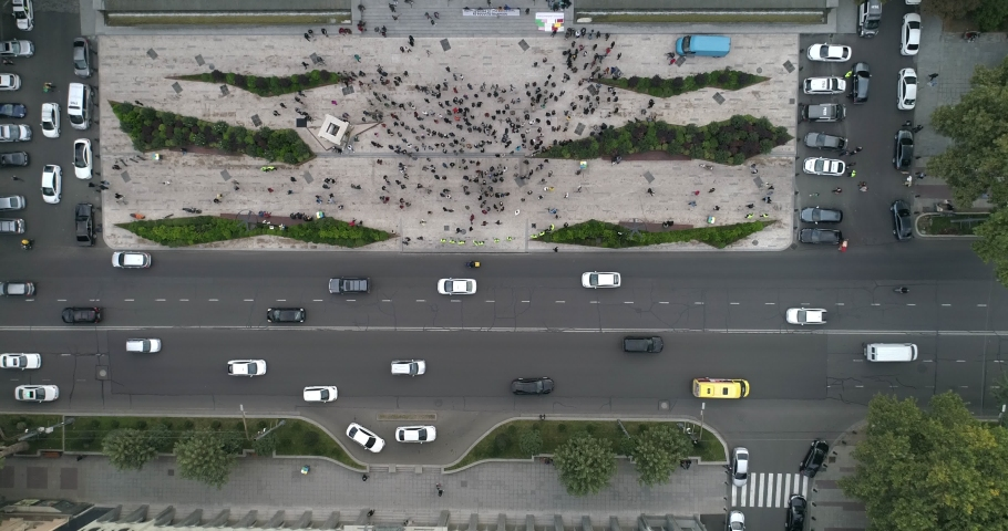 Overhead shot on protesting people and cars moving on the street