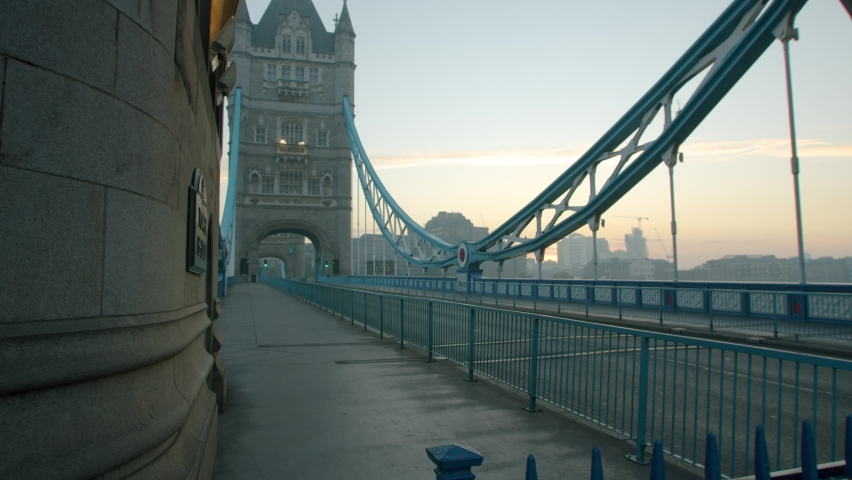 Lockdown in London, beautiful Tower Bridge completely empty during the Coronavirus pandemic 2020, in morning sunrise light. Royalty-Free Stock Footage #1061278090