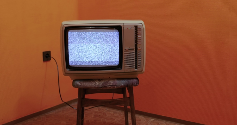 Vintage TV set on a chair in an empty room | Shutterstock HD Video #1061290774