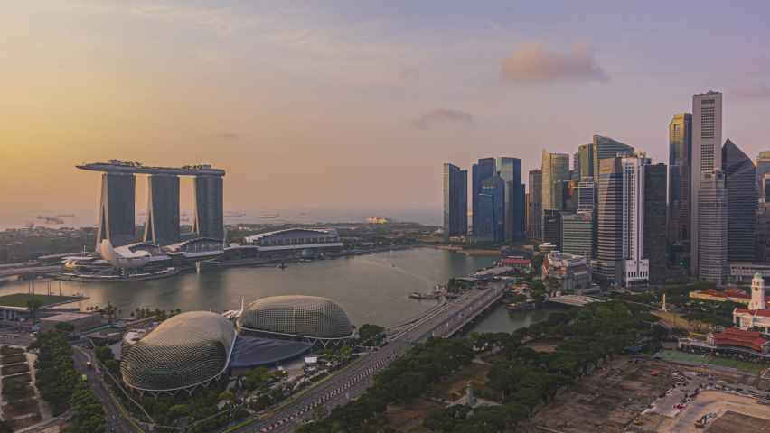 Singapore Sunset Beautiful Time lapse of day to night of Singapore city skyline from aerial and high angle overlooking Marina bay and CBD area. Pan up motion timelapse.  Royalty-Free Stock Footage #1061293486