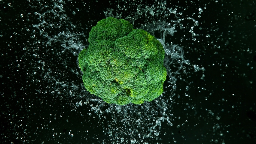Super Slow Motion Shot of Rotating Broccoli, 1000 fps. Royalty-Free Stock Footage #1061295352