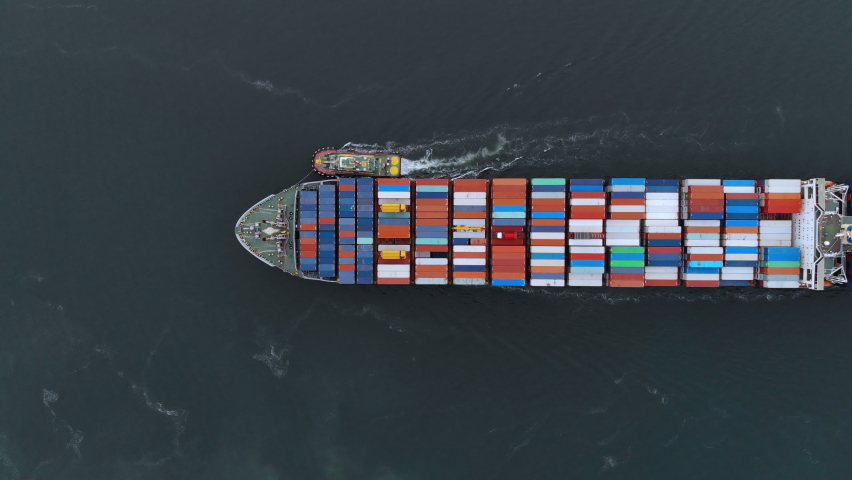 Aerial top view of cargo ship carrying container and running with Crew that working rope stand by for tug boat. | Shutterstock HD Video #1061295511