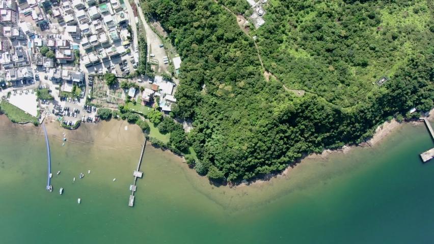 Hong Kong Tseng Tau Tsuen waterfront houses, Aerial view.   Shutterstock HD Video #1061296450