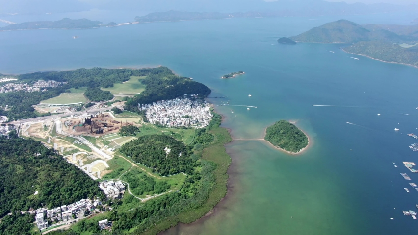 Hong Kong Tseng Tau Tsuen waterfront houses, Aerial view.   Shutterstock HD Video #1061297206