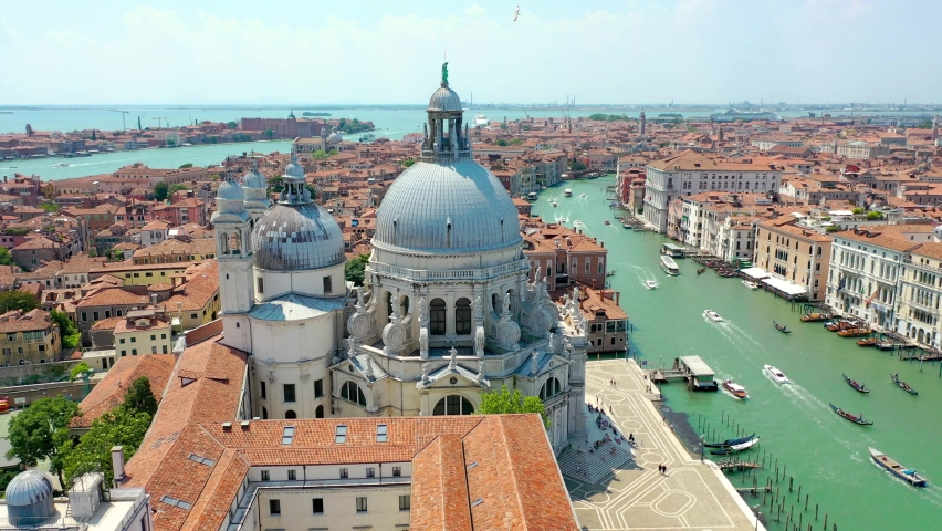 Aerial view of Venice, Italy. Basilica di Santa Maria della Salute, Grand Canal and lagoon. Venice skyline. Panorama of Venice from above in summer. Royalty-Free Stock Footage #1061299966