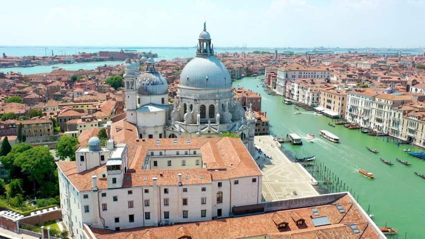 Aerial view of Venice, Italy. Basilica di Santa Maria della Salute, Grand Canal and lagoon. Venice skyline. Panorama of Venice from above in summer. Royalty-Free Stock Footage #1061299969