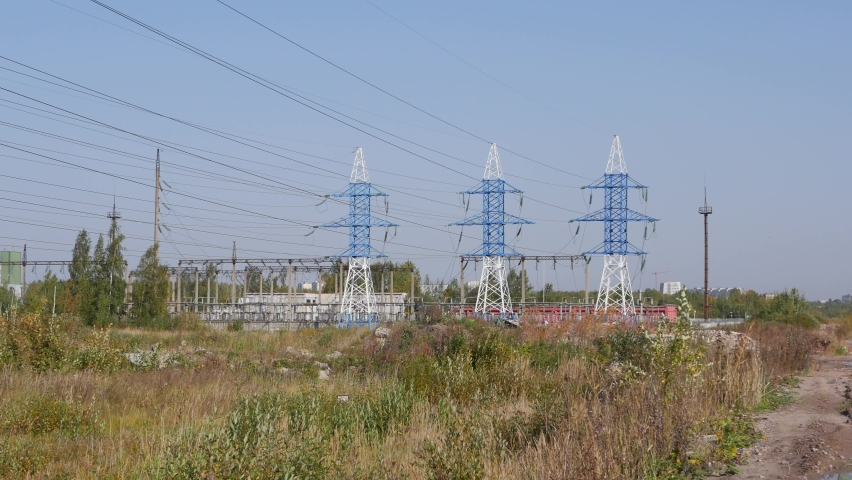 Power lines on the sky background. Power line towers in countryside. Concept of ecology, environmental protection. High quality 4k footage | Shutterstock HD Video #1061316688