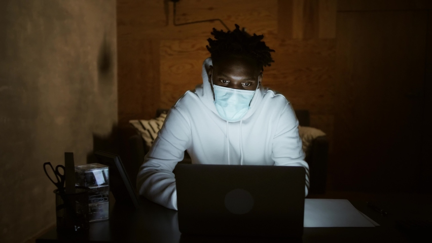 Smiling millennial african american casual man working with apps or communicating online on laptop | Shutterstock HD Video #1061317684