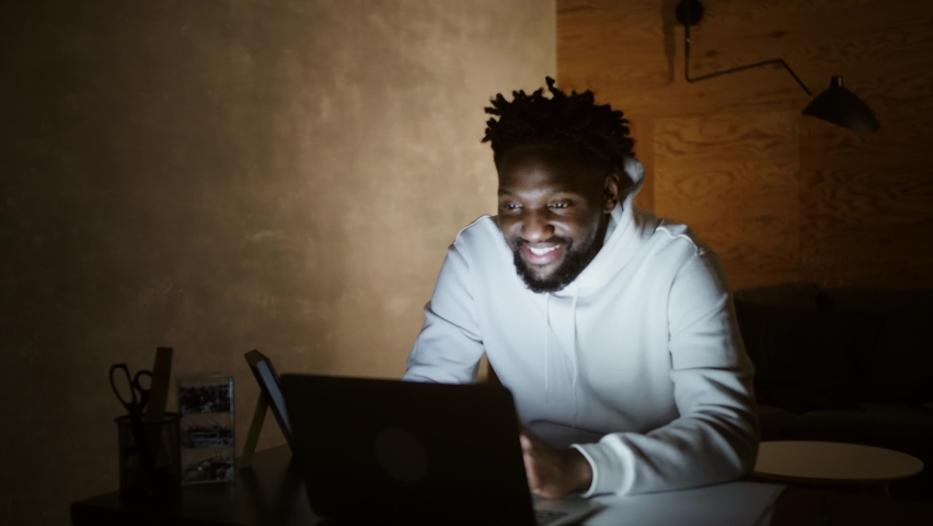 Smiling millennial african american casual man working with apps or communicating online on laptop | Shutterstock HD Video #1061317687