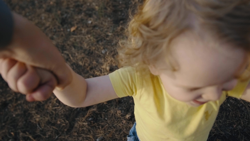 Father holding spinning beautiful little son. Playing outside with loving parent. Happy childhood. | Shutterstock HD Video #1061319871