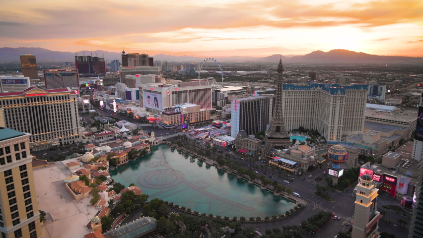 LAS VEGAS, NEVADA - APRIL 18, 2018: Hotels and Casinos along the strip at dusk. | Shutterstock HD Video #1061326132