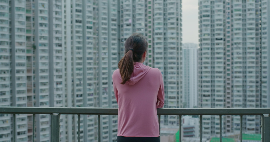Woman look at the city view with building background   Shutterstock HD Video #1061333788
