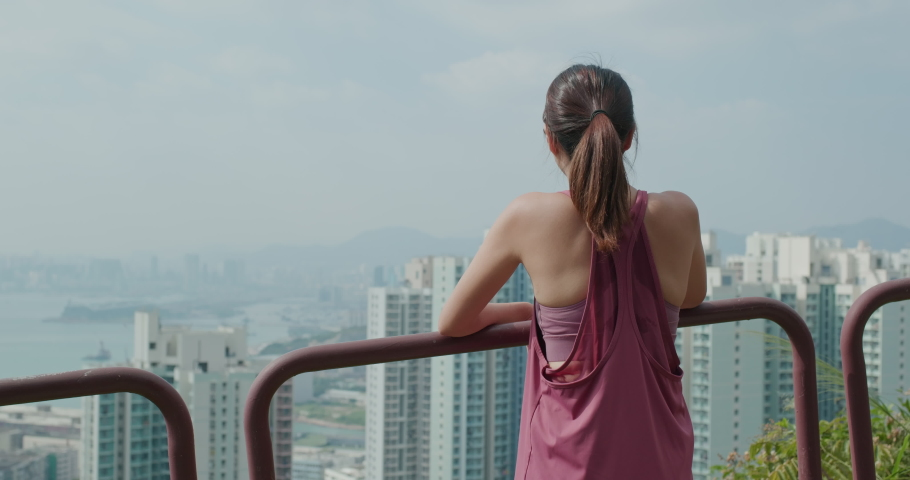 Woman look at the city view from mountain   Shutterstock HD Video #1061333803