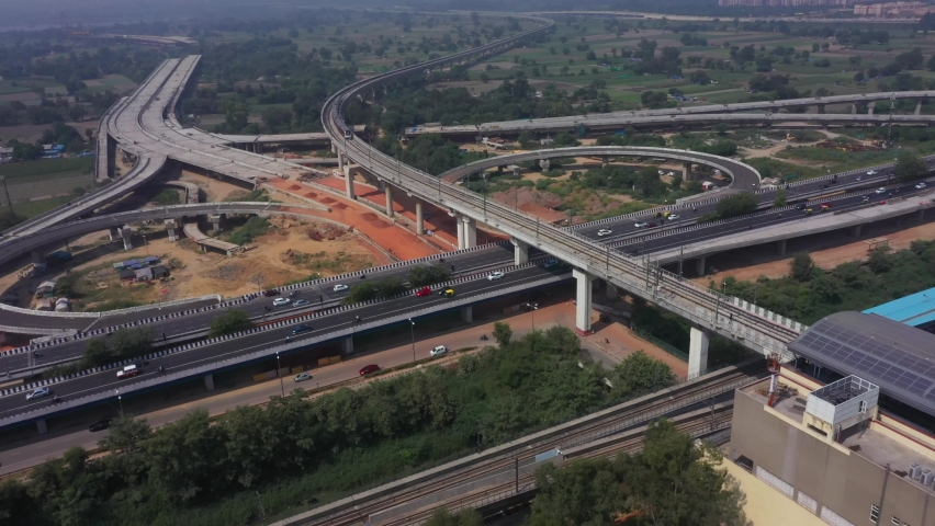 An aerial shot of Two Delhi Metro Trains crossing each other at Mayur Vihar,New Delhi, India Royalty-Free Stock Footage #1061339761