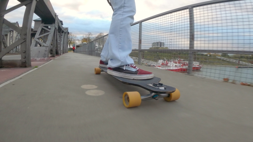 Skateboard crossing the bridge, close up in foot   Shutterstock HD Video #1061355175
