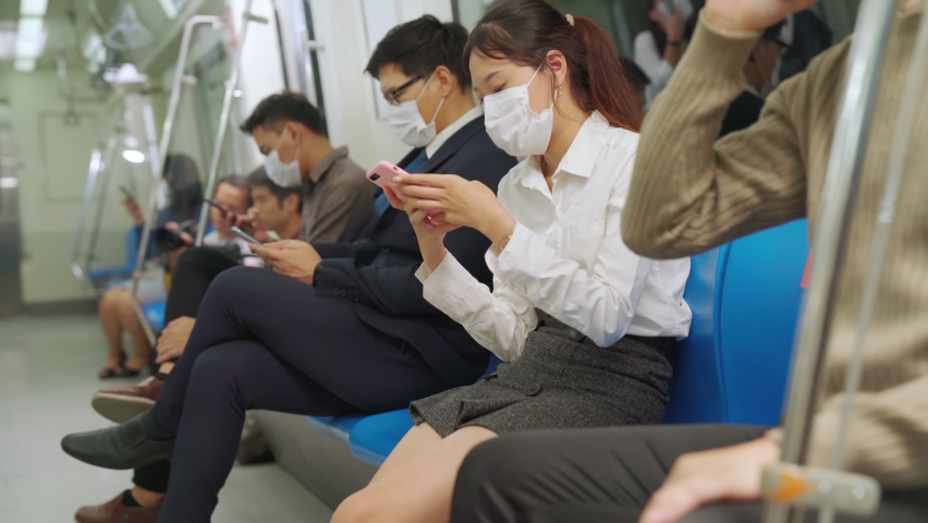 Crowd of people wearing face mask on a crowded public subway train travel . Coronavirus disease or COVID 19 pandemic outbreak and urban lifestyle problem in rush hour concept . | Shutterstock HD Video #1061359894