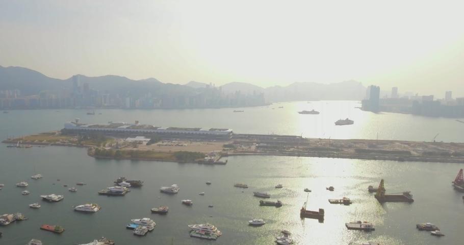 Sunset aerial shot of Kai Tak Cruise Terminal at Kowloon Bay Hong Kong   Shutterstock HD Video #1061364412