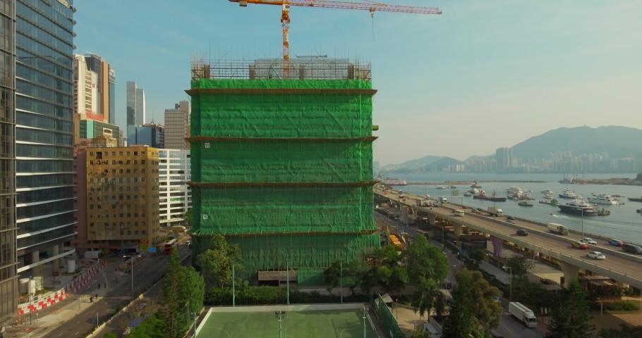 Aerial rising shot of a construction site at Kwun Tong Typhoon Shelter in Kowloon Bay, Kwun Tong, Hong Kong   Shutterstock HD Video #1061364418