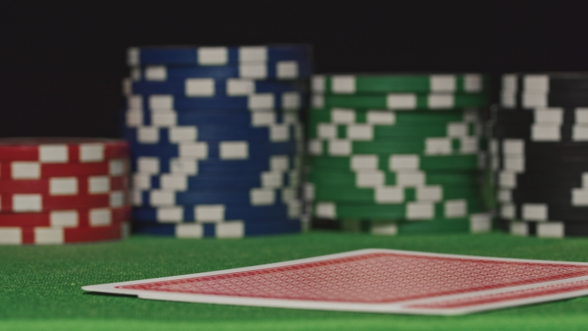 Two aces placed on a pile of poker chips. | Shutterstock HD Video #1061374930