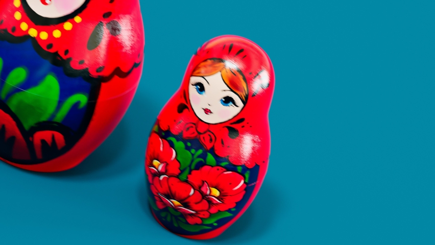 Beautiful handmade matryoshka dolls. Seamless looping animation of smaller babushka jumping out from the bigger one. Cute traditional wooden Russian toys. Souvenirs painted with colourful ornaments.  Royalty-Free Stock Footage #1061405221