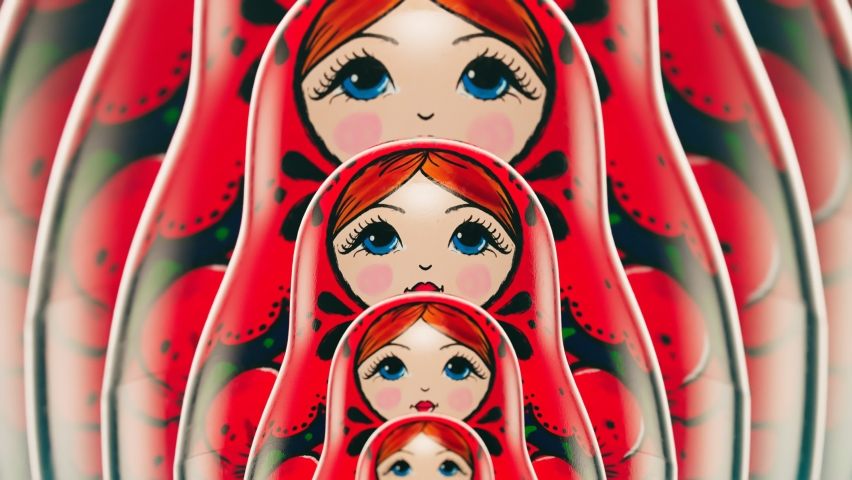 Beautiful handmade matryoshka dolls in a row grow infinitely. Front view on babushkas placed one after another. Traditional wooden Russian toys. Art souvenir painted with colourful ornaments. Looping  Royalty-Free Stock Footage #1061405242