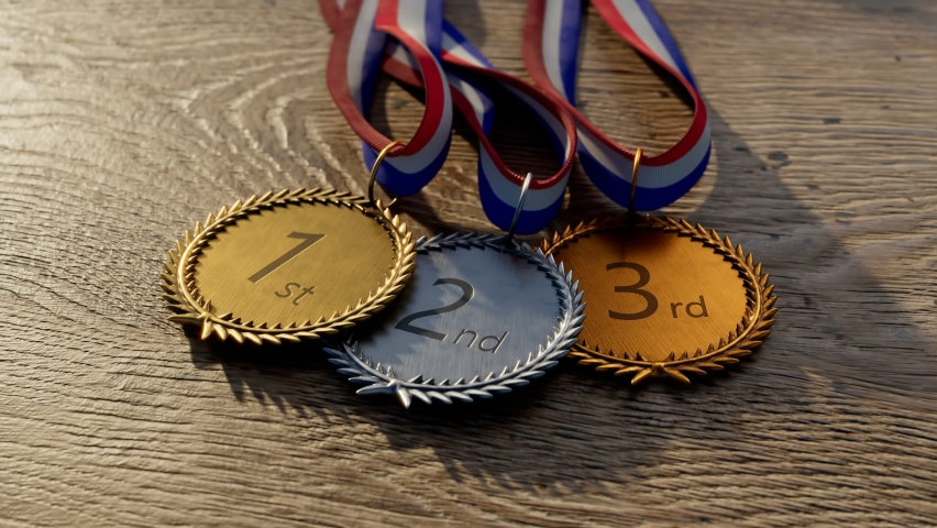 Set of shiny Olympic awards for top three winners. Silver, gold, bronze sports medals with ribbons for champions. First prize. Symbol of winning competition, success, victory, championship. Triumph.  Royalty-Free Stock Footage #1061405320
