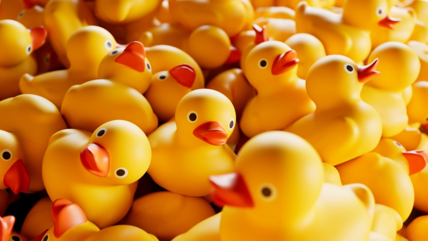 Seamless looping animation of the pile of rubber ducks. A huge amount of cute yellow toys forming stacks. Symbol of play in the water while bathing. Plastic ducklings ready for child's fun in the bath