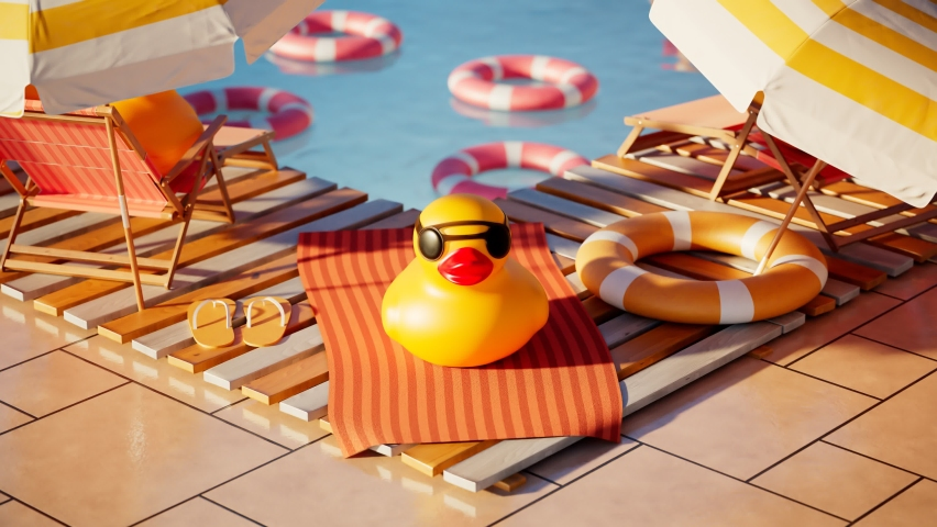 Rubber duck in sunglasses in relaxation zone in the swimming pool. Cute yellow toys on a beach towel and sunbeds under umbrellas. Floating life rings and ducks in the background. Joyful atmosphere.